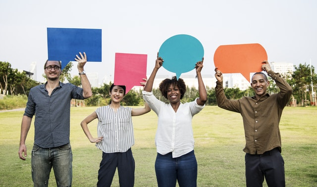 Group of diverse people holding thought bubbles above their heads