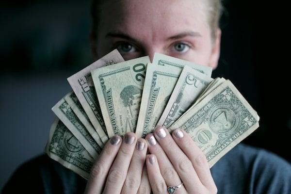Man holding a fan of cash