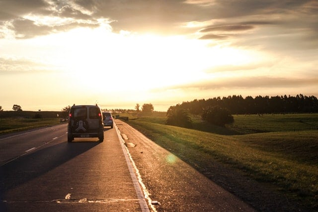 Car driving down a rural highway