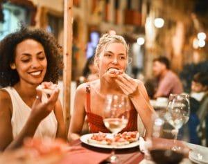 woman eating at company holiday party