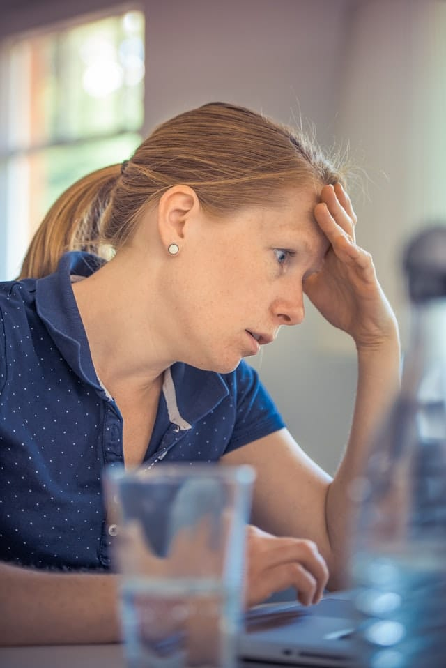 Woman looking annoyed at work