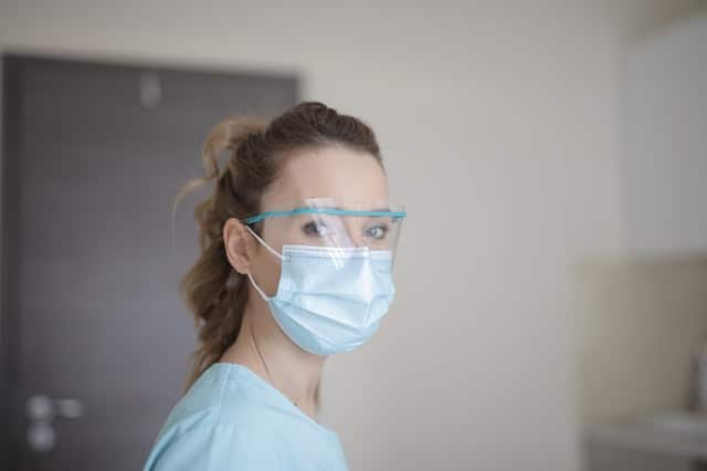 woman-in-blue-shirt-wearing-face-mask-3881247
