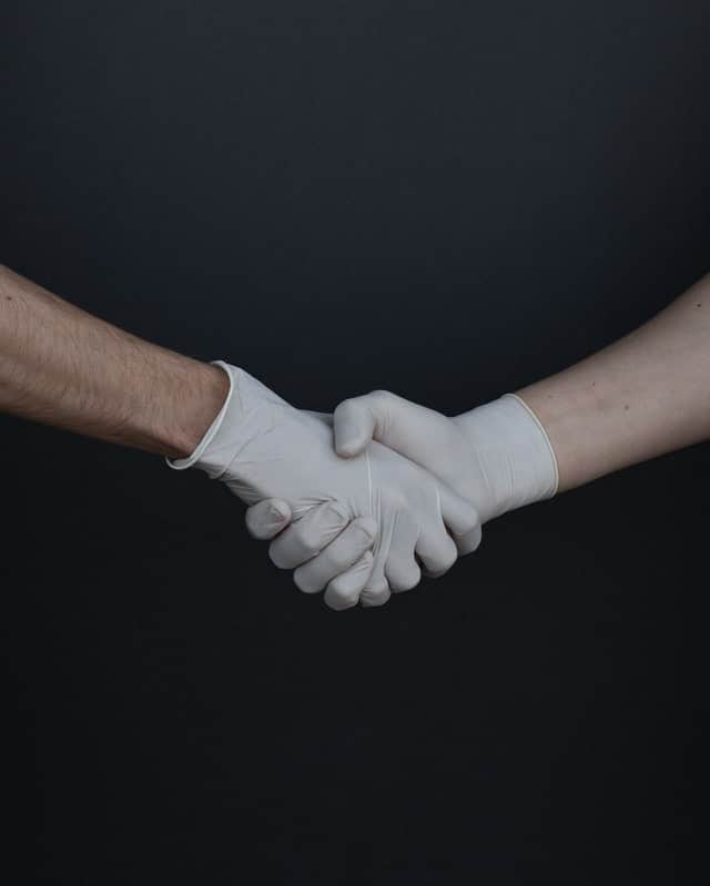 people-shaking-hands-in-latex-gloves