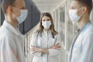 woman-in-white-coat-wearing-white-face-mask