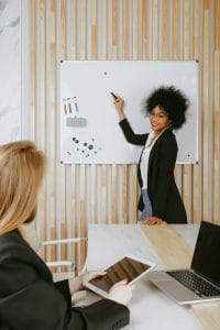 woman-pointing-at-whiteboard
