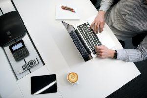 Man types on computer