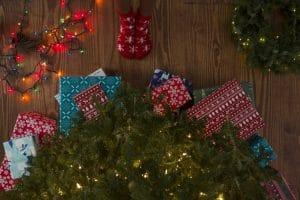 Presents underneath a holiday wreath.